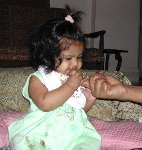 Actual photo of baby's first fingerful of ragi porridge.