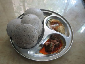 Soak 1 cup brown rice and 1.5 cups whole urad or urad dal with peel intact.  Grind and allow to rise overnight.  Steam in idli plates as usual.   Shown with avakayi and idli poDi.