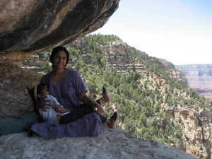 The author nursing her daughter at the grand canyon, Arizona.