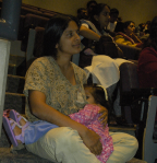 Nursing my daughter while attending a meeting.