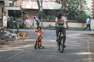 Disha rides her bicycle with Appa