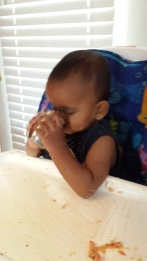 Aanya sips some water.
