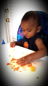 Aanya is focused on eating upma.