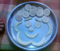 Slice banana and cut apple into thin sections. Arrange in a happy face! Chetana K, Bangalore.