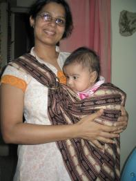 Seema carries Mihika in the sling.