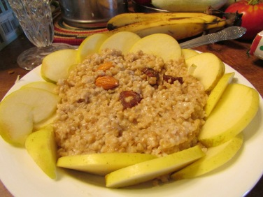 Steel cut oats, soaked and cooked. Topped with almond and date and surrounded with sliced apple.