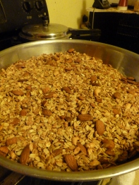 We started with 18 cups of oats and now have 27 cups of granola!