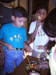Kids make colourful fruit sticks
