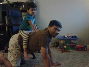 Shishir gets a ride on the elephant's back.