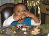 One - year old Aanya has lunch.