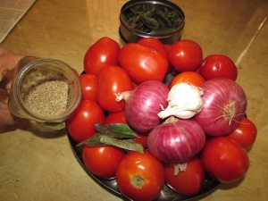 Soon to be tomato soup: Tomato, onion, garlic, basil, ajwain.  Not pictured:  salt, lemon and oil.