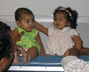 Babies on the train.  It is unclear whether they have doubled their birth weight.