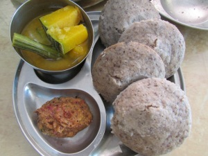 Kodo millet idli served with pacchadi and sambar