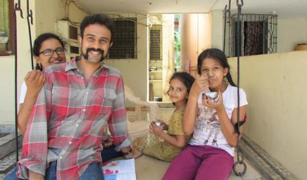 Chetana, Karthik, Disha and Khiyali on the porch swing.