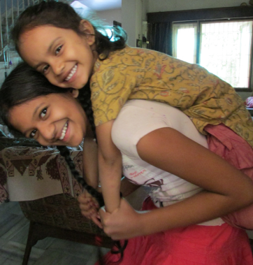 Disha enjoys a piggyback ride.