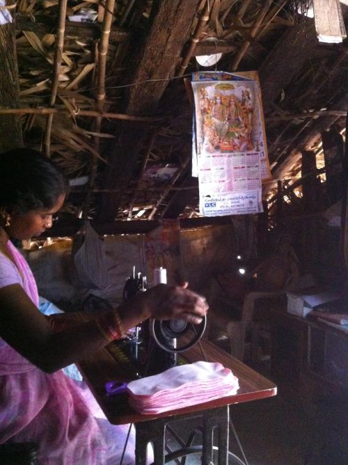 Woman sews cloth pads at home in a village in Srikakulam District.  Photo Courtesy Jivika.