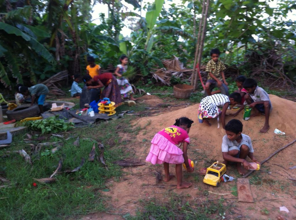 Children making up games with toys from the toy library in Appalagraharam.