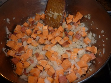 Add sweet potato and stir-fry with garlic and onion.