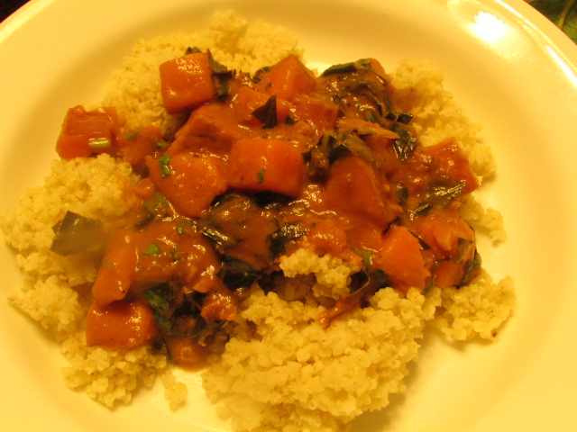 Stew made of collard green and sweet potato served with millet.