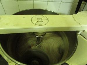 Soaked ragi (finger millet) and urad (black gram) are whirring under the stones of the wet grinder.