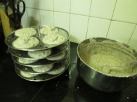 Idli plates are loaded with ragi + urad batter and are ready to steam.