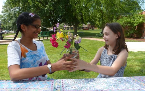 Selah presents flowers for Khiyali's birthday