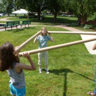 Children use cardboard tubes to talk to each other in amplified whispers.