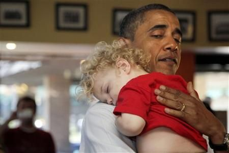 Baby dozes off on Obama's shoulder